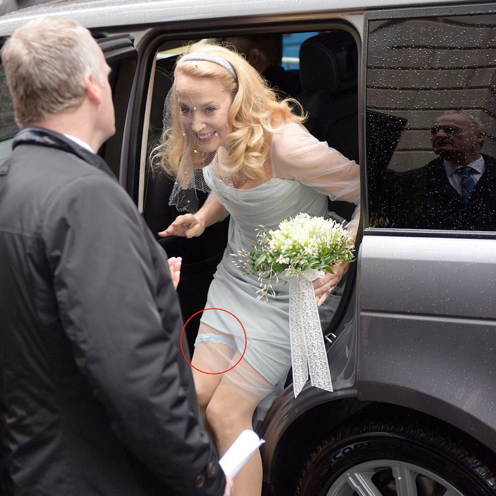 Jerry Hall wearing a blue garter