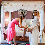 Meena and her Bridesmaid helping with Garter