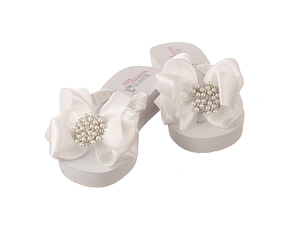 A pair of Bridal Flip Flops designed especially for Brides when they need to take off their high heels