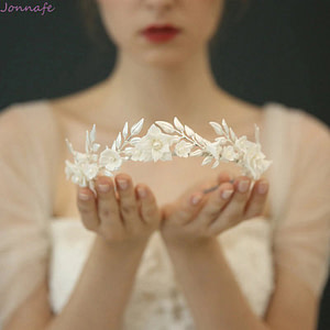 Delicate white porcelain flower and leaf wedding crown