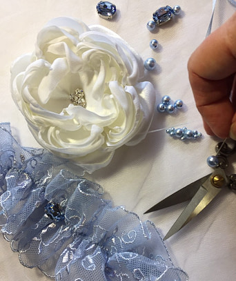 About Us and our Bridal Accessories made with lace, pearls, satin and rhinestones