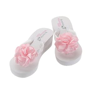 High wedge heeled flip flops with large pink satin roses