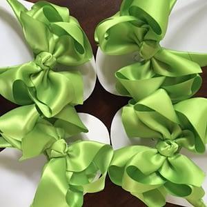 Large apple green coloured bows on high wedge heel flip flops