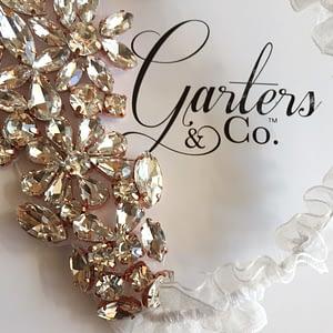 Gorgeous Rhinestones set into a Rose Gold setting on organza wedding garter