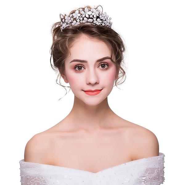 Bride wearing floral design Tiara