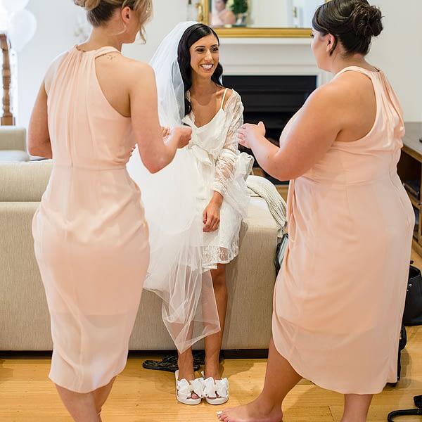 Bride wearing Bridal Flip Flops with her Bridesmaids