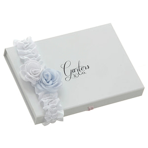 White satin garter with blue and white roses