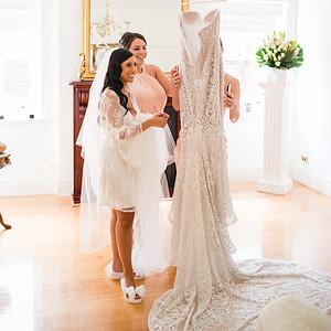 Bride wearing her Bridal Flip Flops and admiring her Wedding Dress