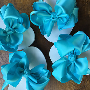Large Tiffany Blue coloured bows on high wedge heel flip flops