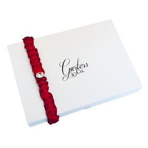 Swarovski crystal on red garter
