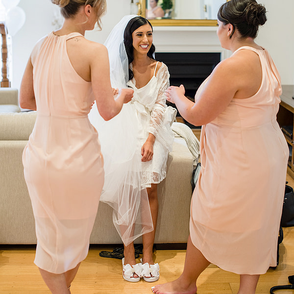 Bride wearing Bridal Flip Flops with her Bridesmaids