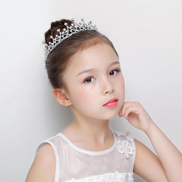 Flower Girl wearing a cut crystal Tiara