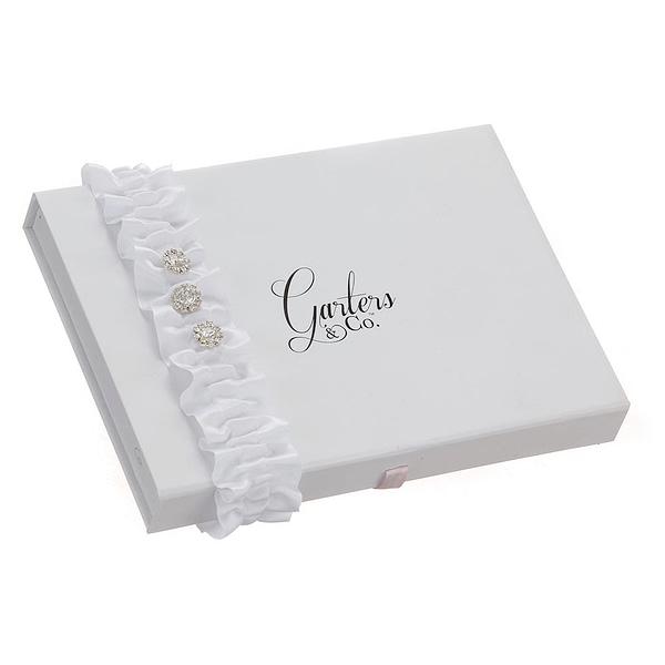 Rhinestones set on a White Wedding Garter