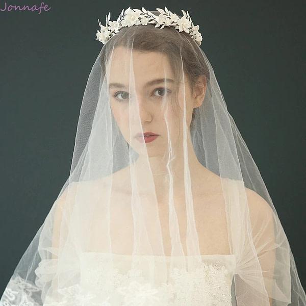 Bride wearing Porcelain Flower and Leaf Wedding Crown