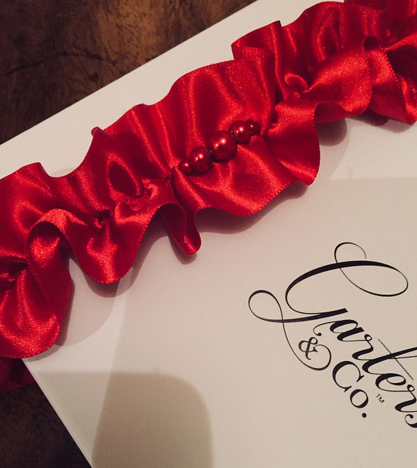 Red Garter with Pearl Centre