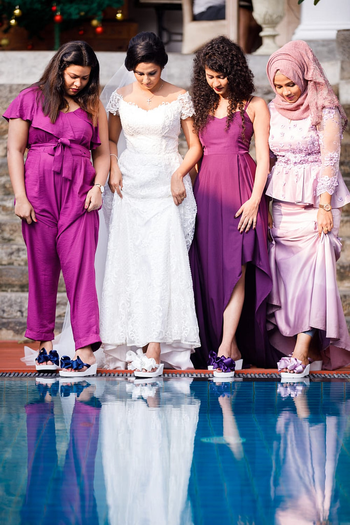 Bride and her Bridesmaids wearing Bridal Flip Flops
