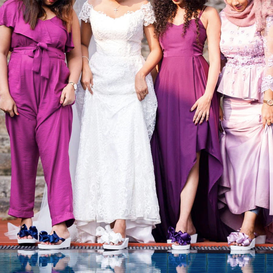 Bride and her Bridesmaids wearing their Flip Flops